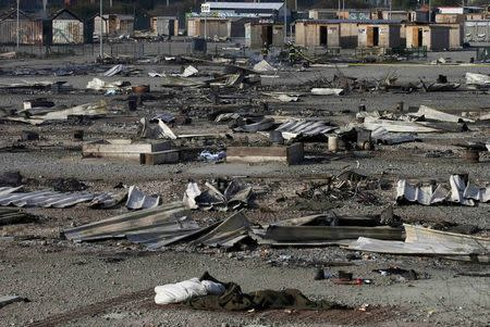 General view of shelters the day after a fire destroyed large swathes of the Grande-Synthe migrant camp near Dunkirk in northern France April 11, 2017 following skirmishes on Monday that injured several people. REUTERS/Pascal Rossignol