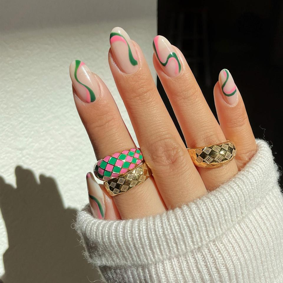 """<p>For those who still have Harry Styles' <a href=""""https://www.allure.com/story/harry-styles-watermelon-sugar-nails-music-video?mbid=synd_yahoo_rss"""" rel=""""nofollow noopener"""" target=""""_blank"""" data-ylk=""""slk:&quot;Watermelon Sugar&quot;"""" class=""""link rapid-noclick-resp"""">""""Watermelon Sugar""""</a> still stuck in their heads, Le delivered a perfectly playful summer nail art look for you (and honestly, the singer, too). The vibes match the song to a T, don't they? </p> <p>Like the last swirls, Le kicked things off with a base coat and a sheer milky-nude polish. Try <a href=""""https://shop-links.co/1742875915465075740"""" rel=""""nofollow noopener"""" target=""""_blank"""" data-ylk=""""slk:Zoya's The Naked Manicure Nude Perfector"""" class=""""link rapid-noclick-resp"""">Zoya's The Naked Manicure Nude Perfector</a>. Then, she added the swooshes of watermelon pink and juicy green with the same thin striper brush. """"The key is to not think too hard about these strokes,"""" Le says. </p> <p>Need some summer polish suggestions for this swirl selection? Check out our list of the <a href=""""https://www.allure.com/gallery/best-new-nail-polish?mbid=synd_yahoo_rss"""" rel=""""nofollow noopener"""" target=""""_blank"""" data-ylk=""""slk:best new shades"""" class=""""link rapid-noclick-resp"""">best new shades</a> on the market. </p>"""