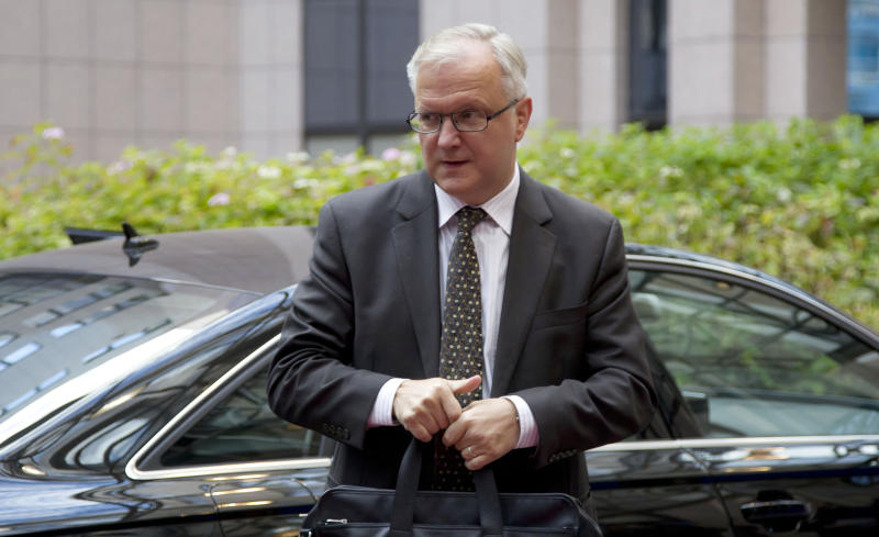 European Commissioner for the Economy Olli Rehn arrives for a meeting of eurogroup finance ministers at the EU Council building in Brussels on Monday, Nov. 26, 2012. Eurozone finance ministers are set to meet in Brussels on Monday to discuss the next installment of bailout money for debt-laden Greece. (AP Photo/Virginia Mayo
