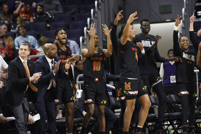 The Maryland bench celebrates a three point basket against Northwestern during the second half of an NCAA college basketball game, Tuesday, Jan. 21, 2020, in Evanston, Ill. (AP Photo/David Banks)