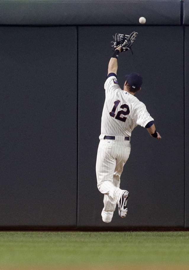 Minnesota Twins right fielder Chris Herrmann misses the catch as Detroit Tigers' Austin Jackson gets a triple during the first inning of a baseball game, Wednesday, Sept. 25, 2013, in Minneapolis. (AP Photo/Jim Mone)