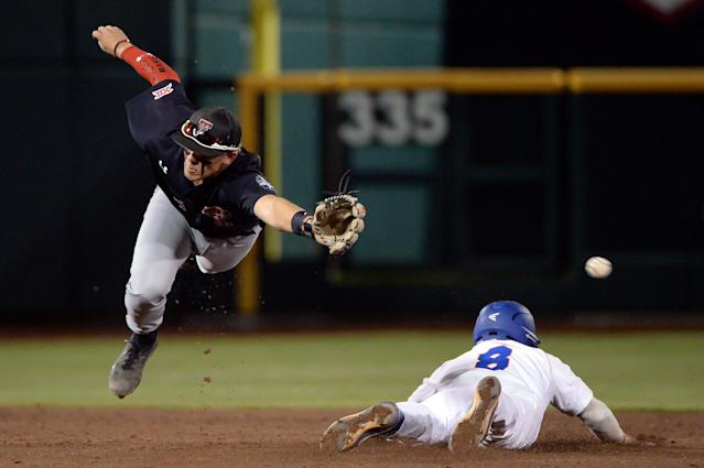 Jun 17, 2018; Omaha, NE, USA; Texas Tech Red Raiders second baseman Brian Klein (5) reaches for a wild throw as Florida Gators shortstop Deacon Liput (8) steals second base in the third inning during the College World Series at TD Ameritrade Park. Mandatory Credit: Steven Branscombe-USA TODAY Sports TPX IMAGES OF THE DAY