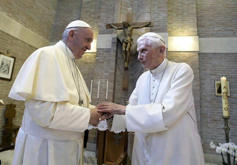 Pope Francis, left, and Pope Emeritus Benedict XVI, meet each other on the occasion of the elevation of five new cardinals, Louis-Marie Ling Mangkhanekhoun, Apostolic Vicary of Pakse, Laos, Anders Arborelius, Bishop of Stockholm, Sweden, Gregorio Rosa Chávez, Auxiliary of the dioceses of San Salvador, El Salvador, Juan José Omella, Archbishop of Barcelona Spain, and Jean Zerbo, Archbishop of Bamako, Malí, at the Vatican, Wednesday, June 28, 2017. (L'Osservatore Romano/Pool photo via AP)