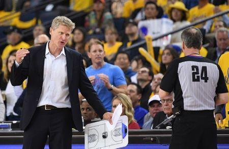 May 22, 2018; Oakland, CA, USA; Golden State Warriors head coach Steve Kerr talks with referee Mike Callahan (24) during the third quarter in game four of the Western conference finals of the 2018 NBA Playoffs against the Houston Rockets at Oracle Arena. Mandatory Credit: Kyle Terada-USA TODAY Sports