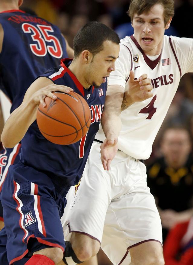 Arizona's Gabe York (1) is fouled by Arizona State's Bo Barnes (4) during the first half of an NCAA college basketball game on Friday, Feb. 14, 2014, in Tempe, Ariz. (AP Photo/Ross D. Franklin)