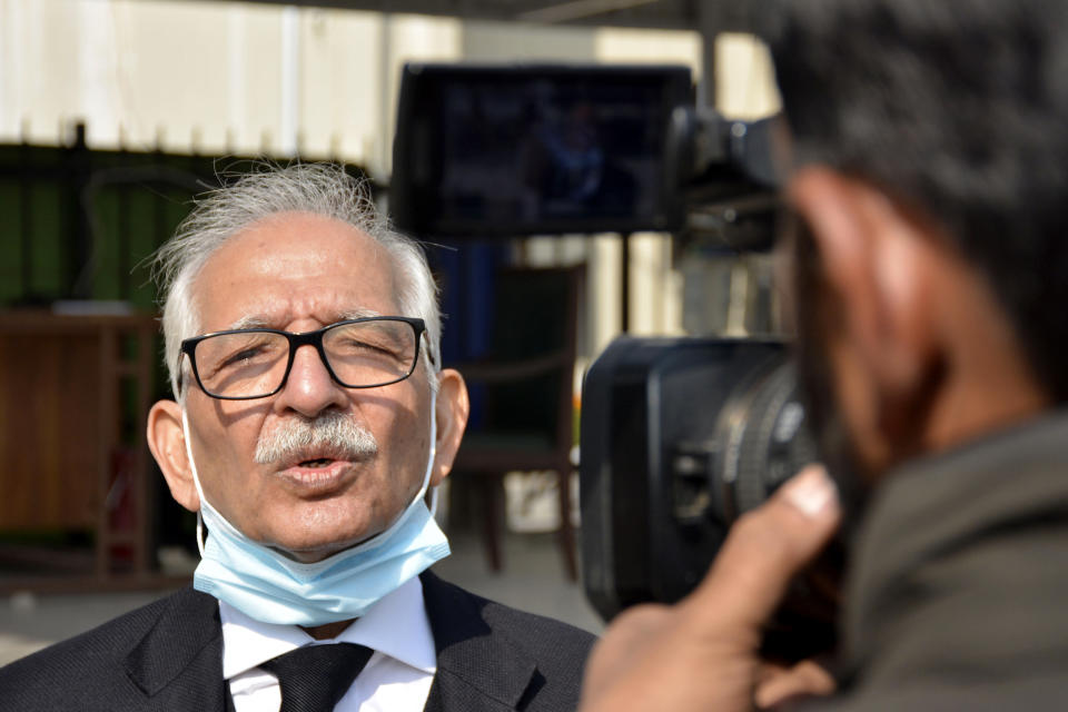 Mehmood A. Sheikh, defense lawyer of British-born Pakistani Ahmed Omar Saeed Sheikh, talks to the media outside the Supreme Court after an appeal hearing in the Daniel Pearl case, in Islamabad, Pakistan, Thursday, Jan. 28, 2021. The court on Thursday has ordered the release of Sheikh convicted and later acquitted in the gruesome beheading of American journalist Pearl in 2002. The court also dismissed an appeal of Sheikh's acquittal by Pearl's family. (AP Photo/Waseem Khan)