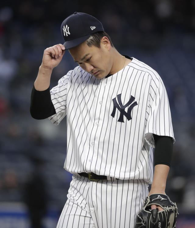 New York Yankees pitcher Masahiro Tanaka walks off the field at the end of the top of the second inning of a baseball game against the Miami Marlins, Tuesday, April 17, 2018, in New York. (AP Photo/Julie Jacobson)