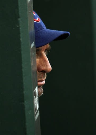 Chicago Cubs manager Dale Sveum watches the action in the second inning of a baseball game against the St. Louis Cardinals, Friday, July 20, 2012 in St. Louis.(AP Photo/Tom Gannam)