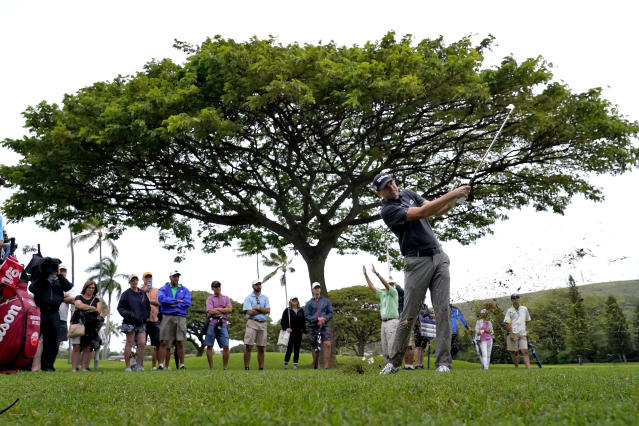 Brendan Steele hits from the rough on the 15th fairway during the third round of the Sony Open PGA Tour golf event, Saturday, Jan. 11, 2020, at Waialae Country Club in Honolulu. (AP Photo/Matt York)