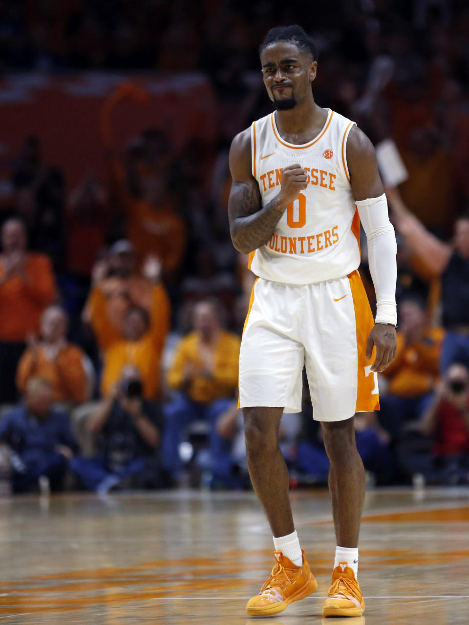Tennessee guard Jordan Bone (0) reacts to hitting a three-point shot during the second half of an NCAA college basketball game against Kentucky Saturday, March 2, 2019, in Knoxville, Tenn. Tennessee won 71-52. (AP Photo/Wade Payne)
