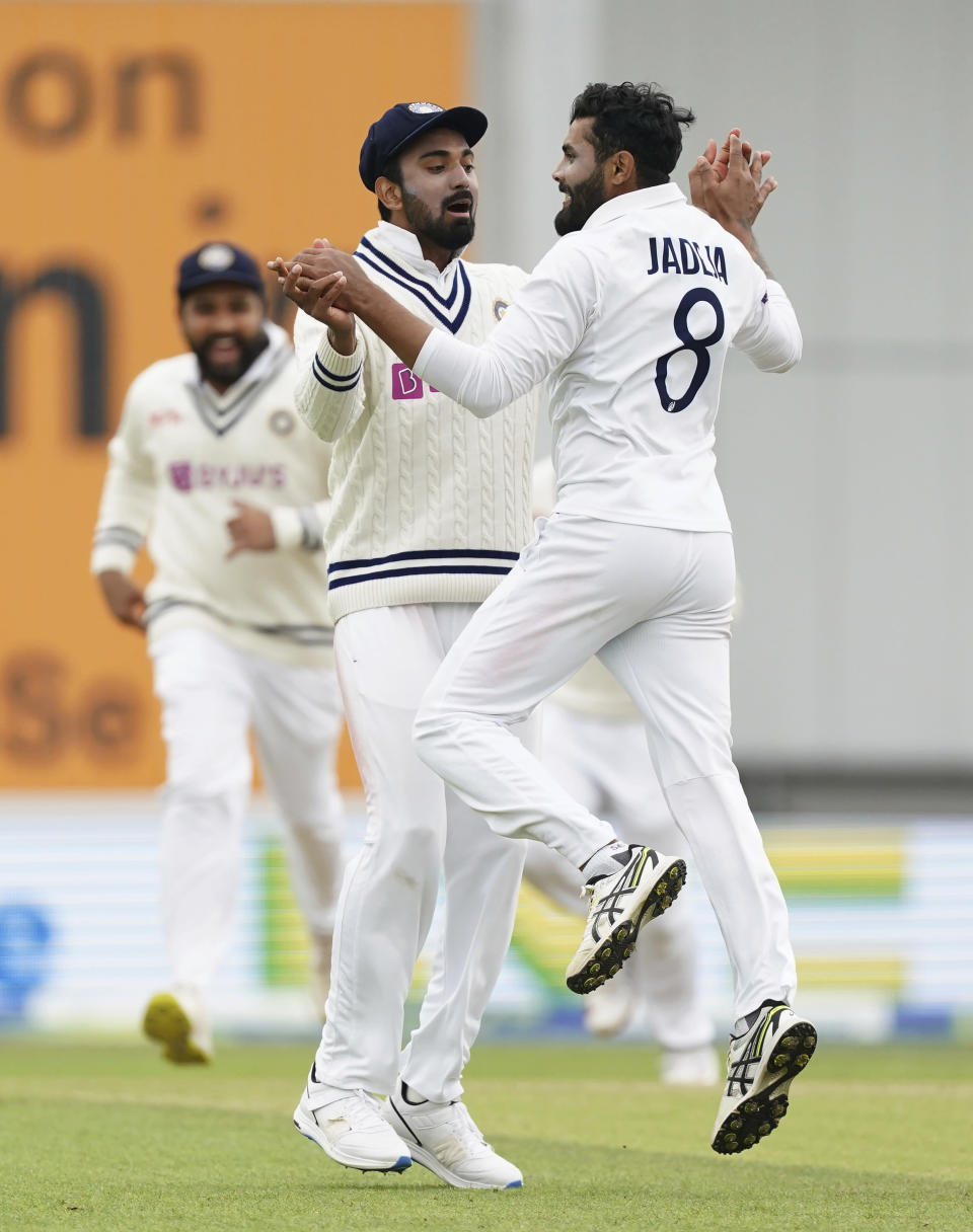 India's Ravindra Jadeja, right, celebrates with teammate KL Rahul after the dismissal of England's Haseeb Hameed during the second day of third test cricket match between England and India, at Headingley cricket ground in Leeds, England, Thursday, Aug. 26, 2021. (AP Photo/Jon Super)