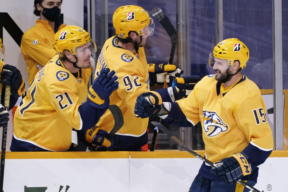 Nashville Predators right wing Brad Richardson (15) is congratulated by Nick Cousins (21) after Richardson scored a goal against the Columbus Blue Jackets in the third period of an NHL hockey game Saturday, Jan. 16, 2021, in Nashville, Tenn. The Predators won 5-2. (AP Photo/Mark Humphrey)