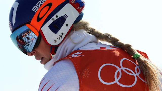 Olympic skier Lindsey Vonn scattered her grandfather's ashes near the downhill course where she won a bronze medal to remember him.