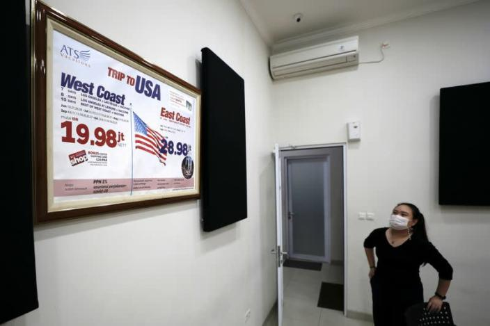 Indonesian travel agency offers holiday packages to U.S. that include COVID-19 vaccine, in Jakarta