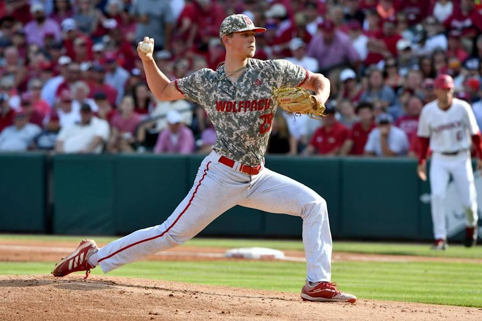North Carolina State pitcher Reid Johnston (29) throws a pitch against Arkansas in the first inning of an NCAA college baseball super regional game Friday, June 11, 2021, in Fayetteville, Ark. (AP Photo/Michael Woods)