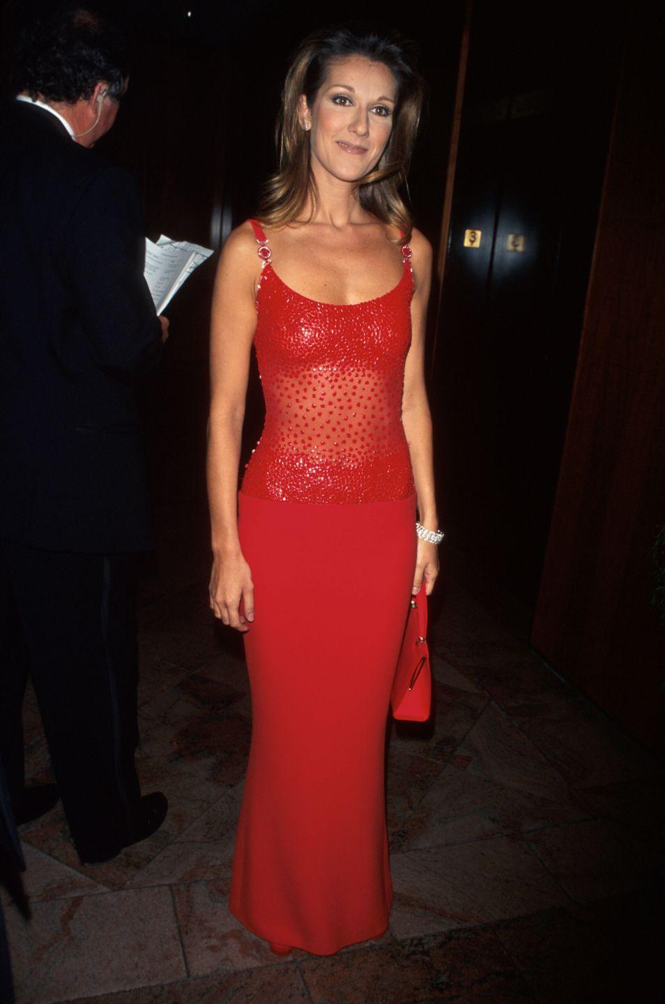 <p>In a red hot look, the singer donned a sparkling red gown that featured a sheer paneling over her stomach. </p>