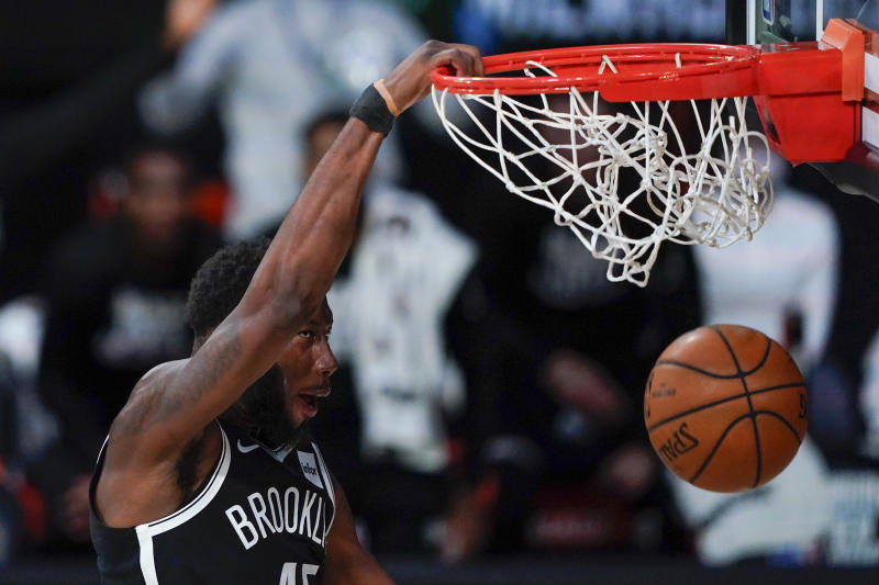 Brooklyn Nets' Donta Hall (45) dunks during a win over the Bucks. (AP Photo/Ashley Landis, Pool)