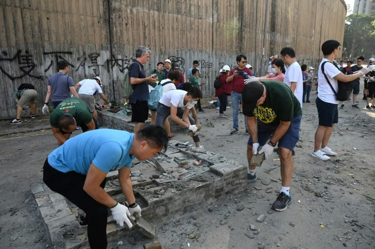 The city remains strewn with debris and barricades following a week-long campaign of roadblocks, vandalism and protest
