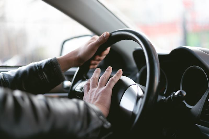 Going to heavy on your horn while driving could end with a hefty fine. A stock image of a man honking horn.