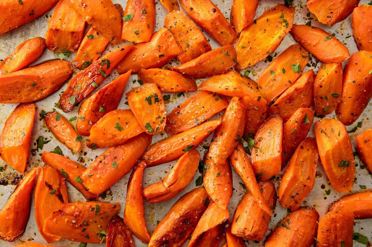 """<p>Our biggest piece of advice: Don't overcrowd the pan. </p><p>Get the <a href=""""https://www.delish.com/uk/cooking/recipes/a29571518/oven-roasted-carrots-recipe/"""" target=""""_blank"""">Roasted Carrots</a> recipe. </p>"""