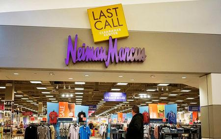 FILE PHOTO - A customer walks by the Neiman Marcus Last Call store in Golden, Colorado, U.S. on January 23, 2014.   REUTERS/Rick Wilking/File Photo