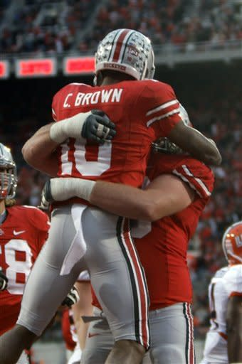 Ohio State wide receiver Corey Brown, left, celebrates his touchdown against Illinois with teammate offensive lineman Andrew Norwell during the fourth quarter of an NCAA college football game on Saturday, Nov. 3, 2012, in Columbus, Ohio. Ohio State won 52-22. (AP Photo/Jay LaPrete)