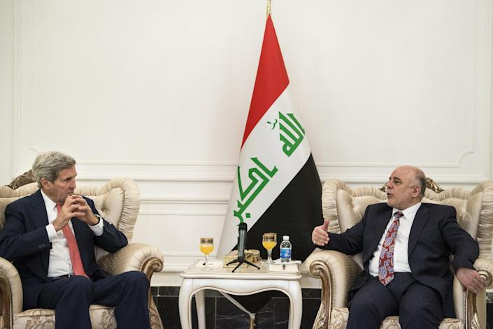 US Secretary of State John Kerry (L) listens as new Iraqi Prime Minister Haider al-Abadi (R) speaks after a meeting on September 10, 2014 in Baghdad (AFP Photo/Brendan Smialowski)