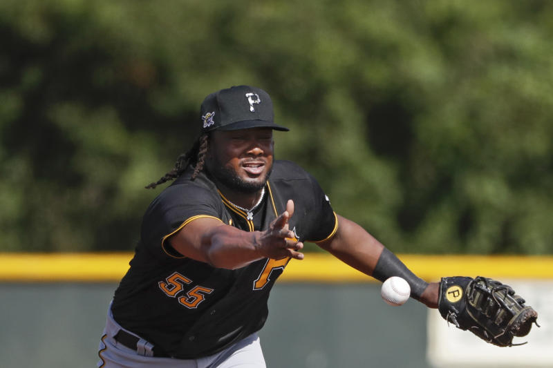 Pittsburgh Pirates' Josh Bell tosses the ball to a teammate during a spring training baseball workout Monday, Feb. 17, 2020, in Bradenton, Fla. (AP Photo/Frank Franklin II)