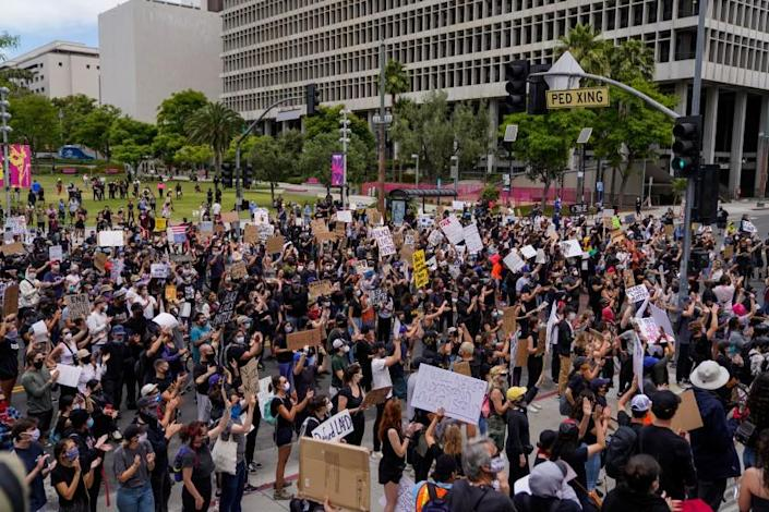 LOS ANGELES, CA - JUNE 02: Protesters outside LA City Hall in downtown Los Angeles on Tuesday, June 2, 2020 in Los Angeles, CA. Protests erupted across the country, with people outraged over the death of George Floyd, a black man killed after a white Minneapolis police officer pinned him to the ground with his knee. (Kent Nishimura / Los Angeles Times)