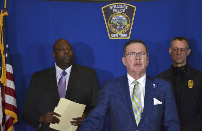 Syracuse Police Chief Kenton T. Buckner, left, Onondaga County District Attorney William J. Fitzpatrick, center, and Syracuse Police Lt. David Brown, right, attend a news conference at the Syracuse Police Department in Syracuse, N.Y., Thursday, Feb. 21, 2019, about Syracuse men's NCAA college basketball head coach Jim Boeheim's involvement in a fatal car accident where he struck and killed a man standing along an interstate in Syracuse. Boeheim struck and killed a man along an interstate late Wednesday night as he tried to avoid hitting the man's disabled vehicle, police say. (AP Photo/Nick Lisi)