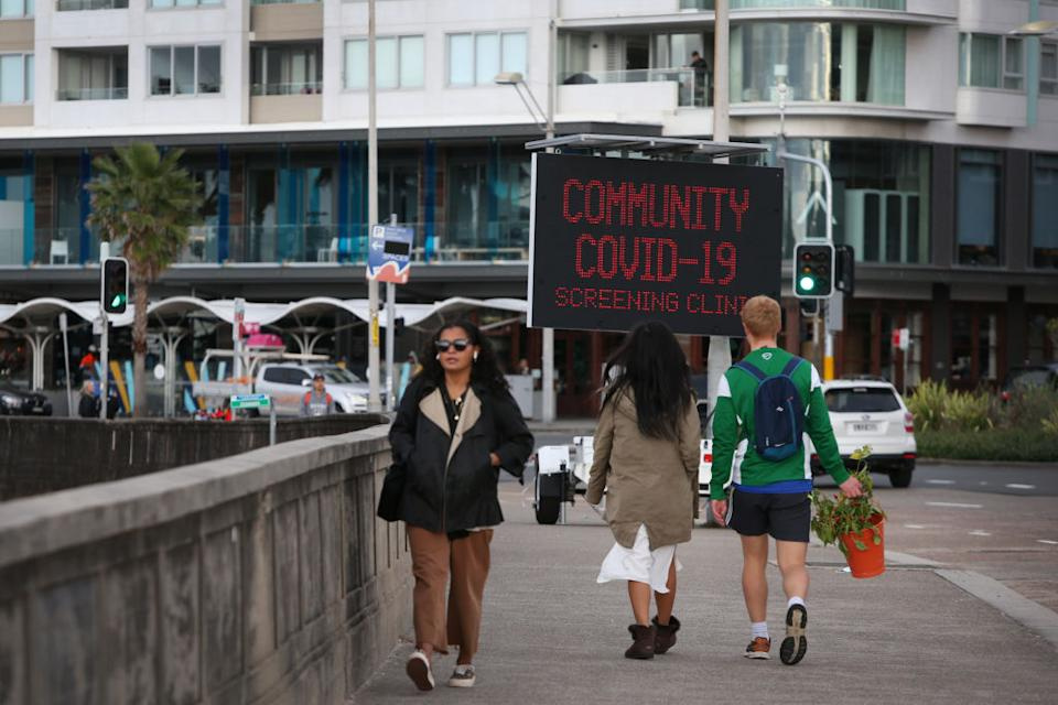A public digital sign displays COVID-19 messages on Campbell Parade in Bondi in Sydney, Australia.