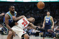 Portland Trail Blazers guard Kent Bazemore (24) and Dallas Mavericks guard Tim Hardaway Jr. (11) are unable to get possession of the ball during the first half of an NBA basketball game Friday, Jan. 17, 2020, in Dallas. (AP Photo/Brandon Wade)