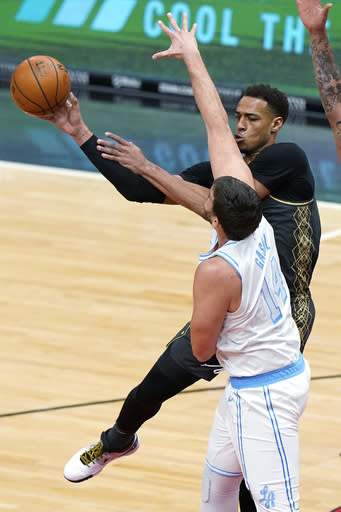 Chicago Bulls forward Daniel Gafford, rear, passes the ball away from Los Angeles Lakers center Marc Gasol during the first half of an NBA basketball game in Chicago, Saturday, Jan. 23, 2021. (AP Photo/Nam Y. Huh)