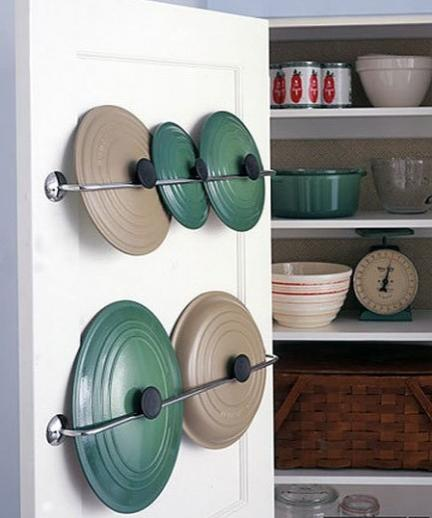 "<div class=""caption-credit""> Photo by: Martha Stewart</div><div class=""caption-title""></div><b>Towel Bar for Pan Lids</b> <br> Use a towel bar to store the lids to pots and pans for easy access and a clean look. <br> <i>Find out more at <a rel=""nofollow"" href=""http://www.marthastewart.com/272813/lid-racks?backto=true"" target=""_blank"">Martha Stewart</a></i>."