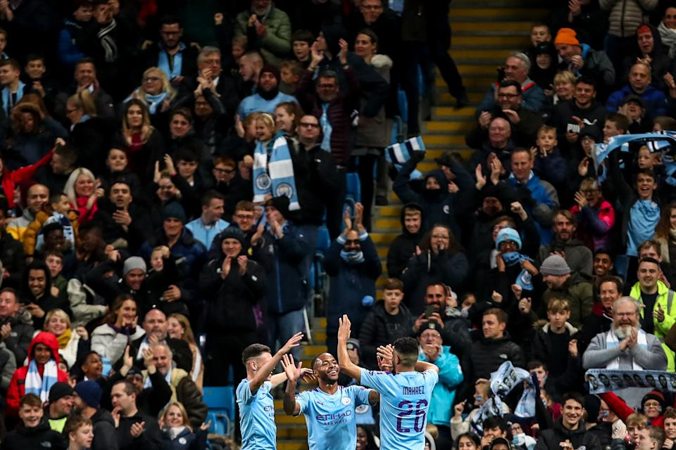 MANCHESTER, ENGLAND - OCTOBER 22: Raheem Sterling of Manchester City celebrates after scoring a goal to make it 5-1 during the UEFA Champions League group C match between Manchester City and Atalanta at Etihad Stadium on October 22, 2019 in Manchester, United Kingdom. (Photo by Robbie Jay Barratt - AMA/Getty Images)