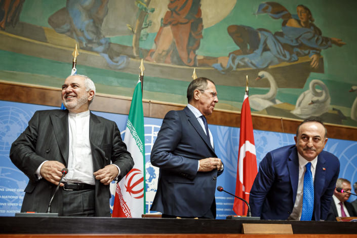 From left to right: Iranian Foreign Minister Mohammad Javad Zarif, Russian Foreign Minister Sergei Lavrov and Turkish Foreign Minister Mevlut Cavusoglu leave after a press conference a day prior to the Syrian Constitutional Committee meeting in Geneva, at the European headquarters of the United Nations in Geneva, Switzerland, Tuesday, Oct. 29, 2019. Representatives from the Syrian government, opposition and civil society are to begin meeting in Geneva on Wednesday. (Valentin Flauraud, Keystone via AP)