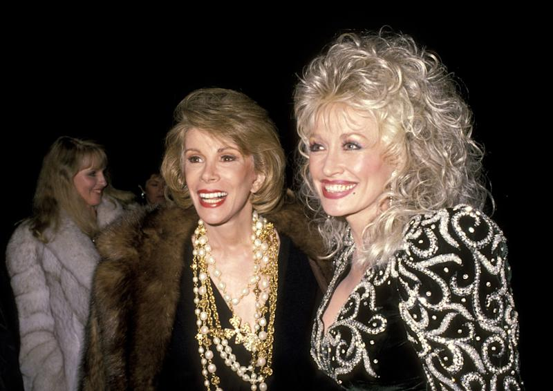 Joan Rivers and Dolly Parton during Sandy Gallin's Christmas Party in 1988 in Beverly Hills. (Ron Galella/WireImage)