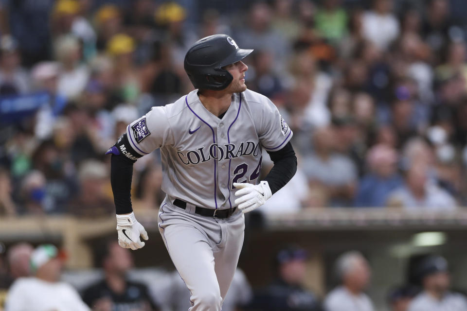 Colorado Rockies' Ryan McMahon watches his grand slam against the San Diego Padres during the first inning of a baseball game Friday, July 30, 2021, in San Diego. (AP Photo/Derrick Tuskan)