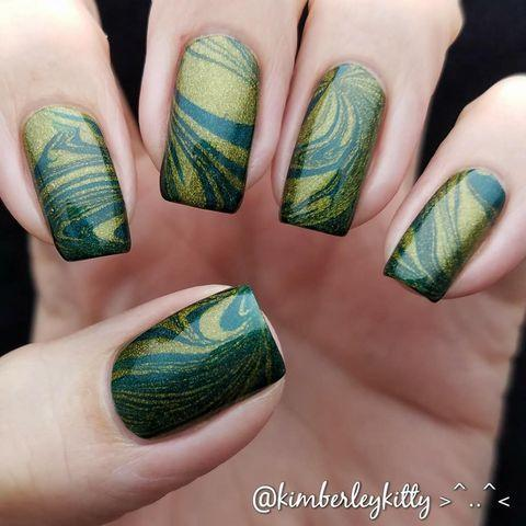 """<p>These nails are out of this world. The water marble style blends a goldish green and deep green to create a more subtle, modern version of the classic St. Paddy's Day nail set.</p><p><a class=""""link rapid-noclick-resp"""" href=""""https://go.redirectingat.com?id=74968X1596630&url=https%3A%2F%2Fwww.etsy.com%2Flisting%2F203439852%2Fbishop-h-gold-olive-green-greyish-blue&sref=https%3A%2F%2Fwww.goodhousekeeping.com%2Fbeauty%2Fnails%2Fg26310821%2Fst-patricks-day-nail-designs%2F"""" rel=""""nofollow noopener"""" target=""""_blank"""" data-ylk=""""slk:SHOP GOLD-GREEN POLISH"""">SHOP GOLD-GREEN POLISH</a></p><p><a href=""""https://www.instagram.com/p/BgNQwGqhHIc/&hidecaption=true"""" rel=""""nofollow noopener"""" target=""""_blank"""" data-ylk=""""slk:See the original post on Instagram"""" class=""""link rapid-noclick-resp"""">See the original post on Instagram</a></p>"""