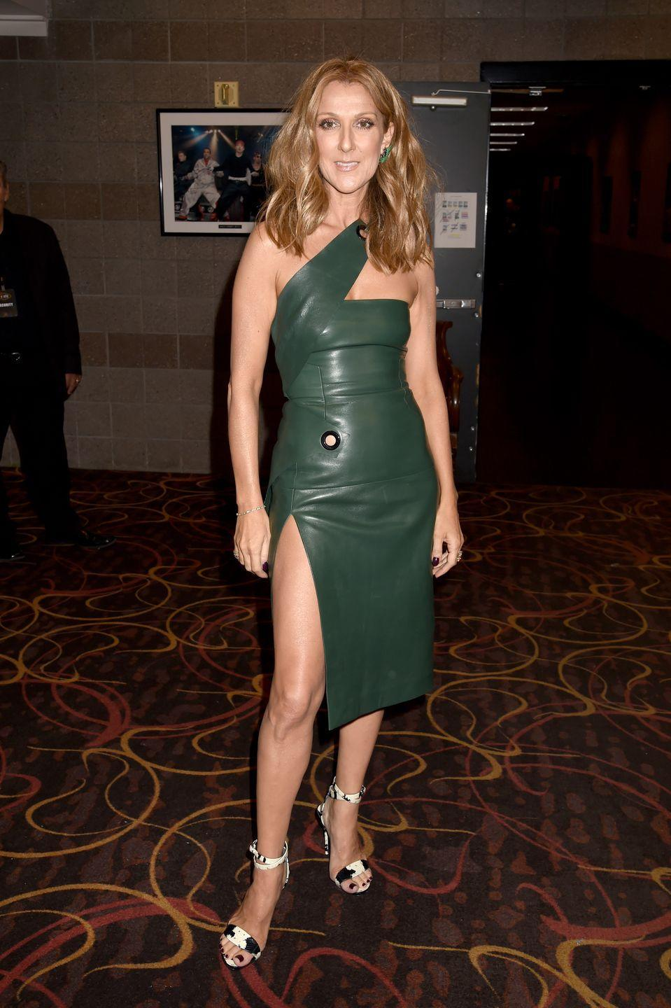 <p>In a green leather mini dress and strappy sandals at the 2015 Billboard Music Awards. </p>