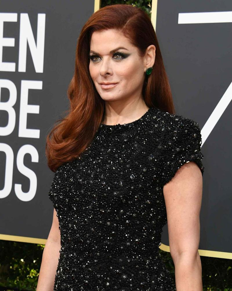 Debra Messing called out E! on their gender equal pay dispute at the Golden Globes while being interviewed by E! host Giuliana Rancic. Source: Getty