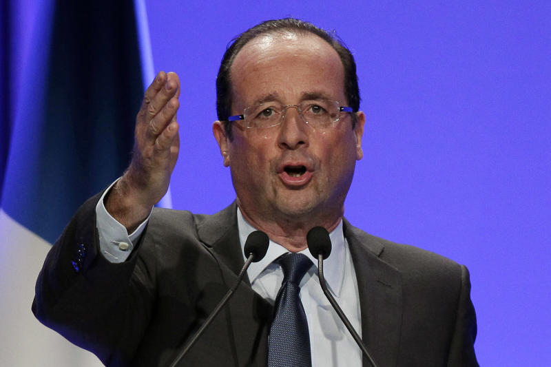 French Socialist Party candidate for the 2012 presidential elections Francois Hollande, gestures as he delivers a speech during a meeting in Aulnay-sous-Bois, a eastern suburb of Paris, Saturday, April 7, 2012. (AP Photo/Michel Euler)