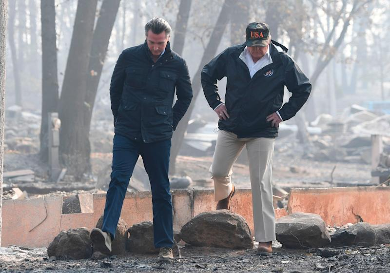 President Donald Trump and then-Lieutenant Gov. Gavin Newsom take a tour through Paradise 10 days after the fire started. (Photo: SAUL LOEB via Getty Images)