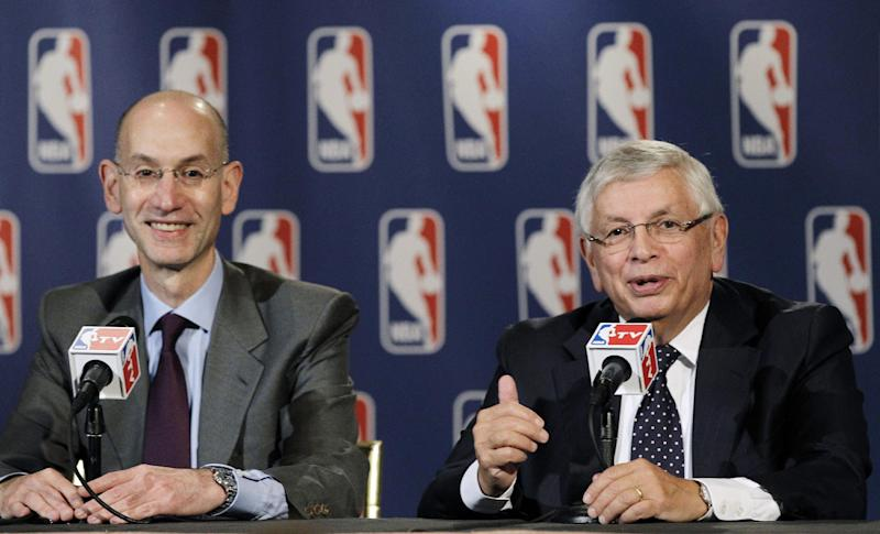 NBA Deputy Commissioner Adam Silver, left, smiles as Commissioner David Stern speaks during a basketball news conference following Board of Governors meetings in New York, Thursday, Oct. 25, 2012. Stern announced he will retire on Feb. 1, 2014, 30 years after he took charge of the league. He will be replaced by Silver. (AP Photo/Kathy Willens)