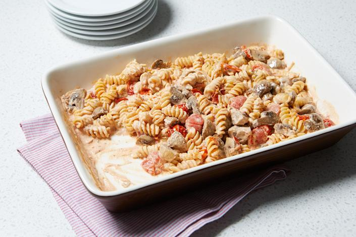 """<p>Cherry tomatoes and mushrooms bake along with goat cheese to form the base of the sauce that cooks the pasta right in the baking dish—no stovetop required. <a href=""""https://www.eatingwell.com/recipe/7897173/baked-tomato-mushroom-goat-cheese-pasta/"""" rel=""""nofollow noopener"""" target=""""_blank"""" data-ylk=""""slk:View Recipe"""" class=""""link rapid-noclick-resp"""">View Recipe</a></p>"""