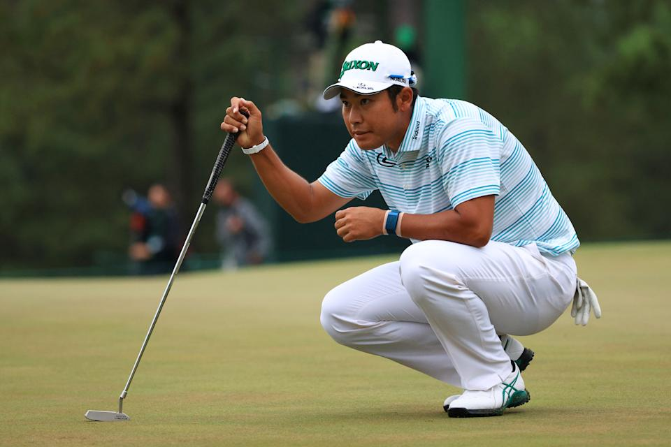 Hideki Matsuyama lines up a putt on the 17th green during the third round of the Masters. (Photo by Mike Ehrmann/Getty Images)