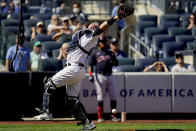 New York Yankees' Gary Sanchez misses a pop fly by Cleveland Indians' Oscar Mercado off starting pitcher Luis Gil in the fifth inning of a baseball game, Saturday, Sept. 18, 2021, in New York. (AP Photo/John Minchillo)