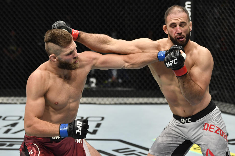 ABU DHABI, UNITED ARAB EMIRATES - JULY 12: (L-R) Jiri Prochazka of the Czech Republic punches Volkan Oezdemir of Switzerland in their light heavyweight fight during the UFC 251 event at Flash Forum on UFC Fight Island on July 12, 2020 on Yas Island, Abu Dhabi, United Arab Emirates. (Photo by Jeff Bottari/Zuffa LLC)