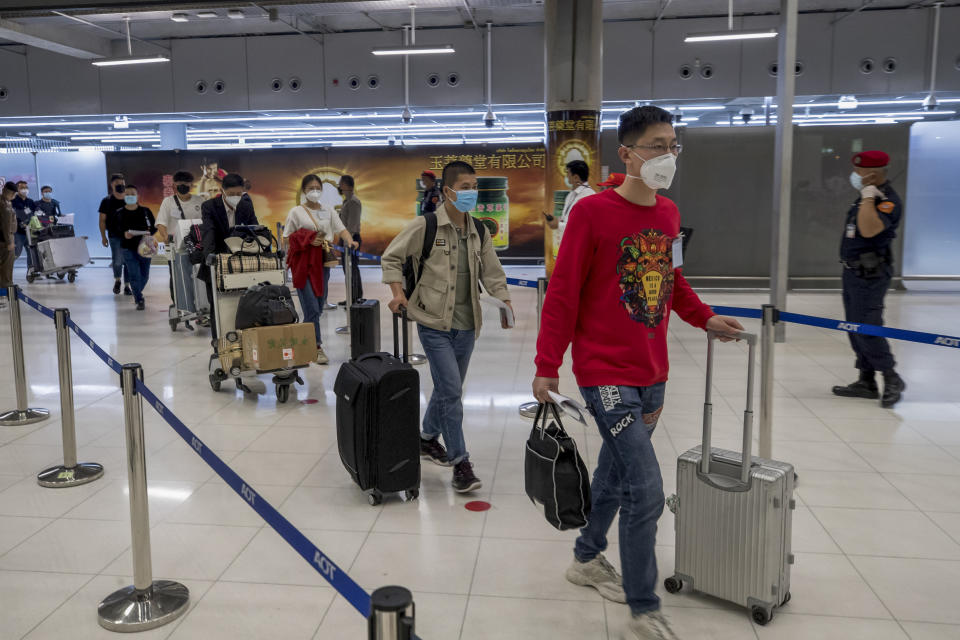 Chinese tourists from Shanghai arrive at Suvarnabhumi airport on special tourist visas, in Bangkok, Thailand, Tuesday, Oct. 20, 2020. Thailand on Tuesday took a modest step toward reviving its coronavirus-battered tourist industry by welcoming 39 visitors who flew in from Shanghai, the first such arrival since normal traveler arrivals were banned almost seven months ago. (AP Photo/Wason Wanichakorn)