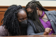 Rep. Cori Bush, D-Mo., right, turns to an aid after testifying about her experience being raped and a subsequent abortion, Thursday, Sept. 30, 2021, during a House Committee on Oversight and Reform hearing on Capitol Hill in Washington. (AP Photo/Jacquelyn Martin)